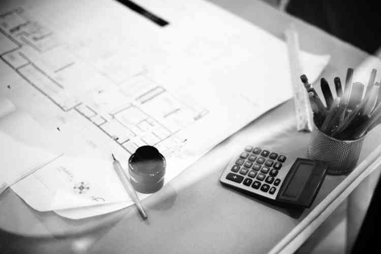 Custom Home, Renovation or Remodel blueprint spread out on desk